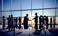 Two Isolated Businessmen Handshaking